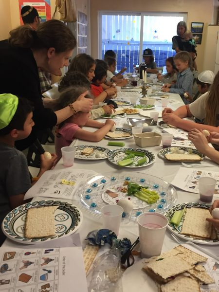 Kids learn some of the rituals involved in preparing a Passover seder.