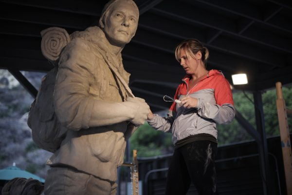 "Sculptor Brittany Ryan at work on the ""Walker"" sculpture."