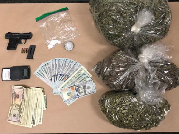 Loot seized by police in a car stop. Photo courtesy of LBPD
