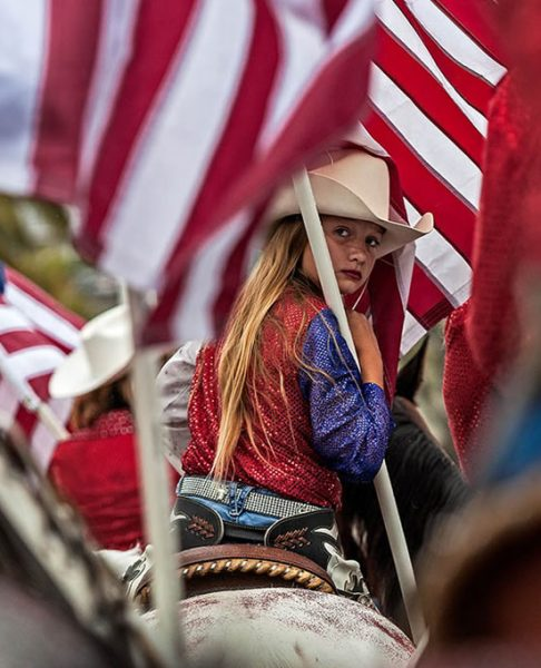 A rider in the American Cowgirls Drill Team awaits the signal to march. Photo by Mitch Ridder.