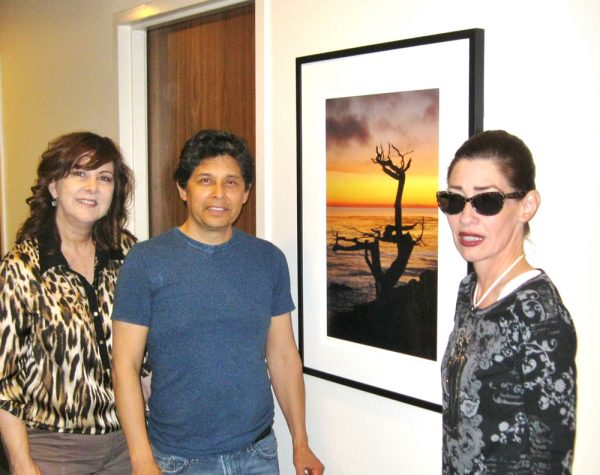 Artist Fund supporters, from left, Wendy Wirth, Hugo Rivera and Ashley Gregg at the City Hall exhibit. Photo by Mike Tauber.