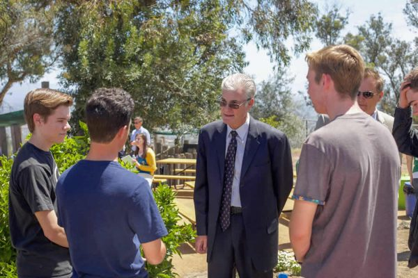 State schools chief Superintendent Tom Torlakson speaks to high school students who assisted with the installation of a solar panel on TOW's garden shed.