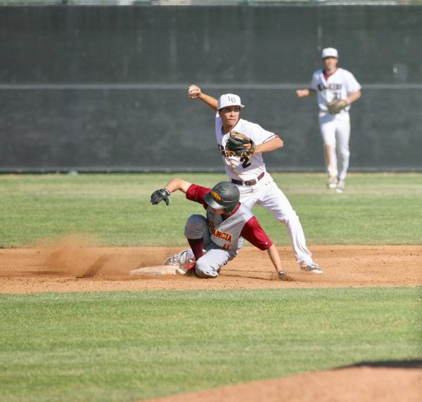 Fielder junior Jared Angus readies a throw against Estancia on Thursday, March 29. Photo by Monica Silver.