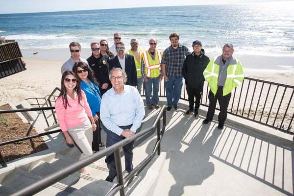 Mayor pro tem Rob Zur Schmiede, center, and staff from the public works and marine safety departments welcome the completion of the Thalia Street beach access stairway. Photo by donee Quincena