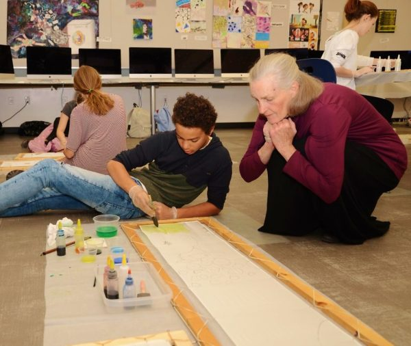 LOCA artist Olivia Batchelder instructs students, whose work is featured in a reception at Forest and Ocean Gallery, Thursday, April 19.Photo by Adreinne Helitzer.