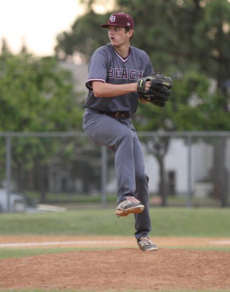 Senior Joe Sweet pitching.