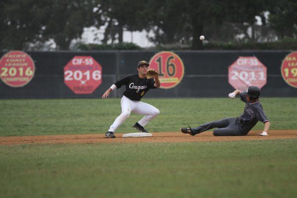 Senior Jack Loechner slides on base.
