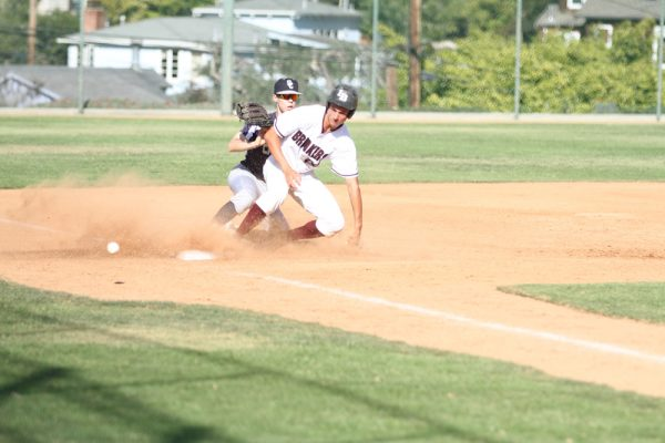 Kolton Freeman tags the base. Photo by Shari Morgan.
