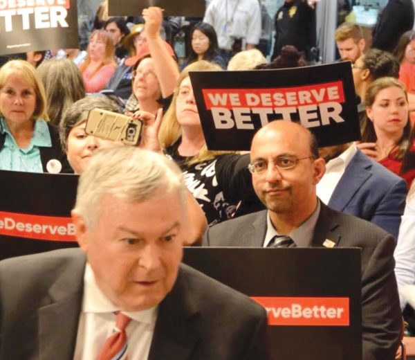 Rep. Dana Rohrabacher, left, spoke in support of Aliso Viejo City Council's action Wednesday, April 3, to reject California's sanctuary city law. A rival candidate, Omar Siddiqui, right, spoke in opposition. Photo courtesy Dan Vo.