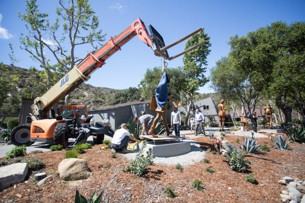 Motorists along Laguna Canyon Road can expect to spot new sculptures, here undergoing installation last week, at the Laguna College of Art & Design main campus. Photo by dondee Quincena.