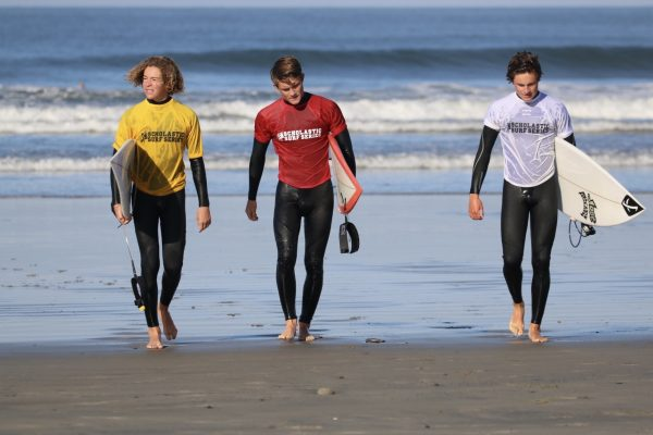 LBHS surfers Joseph Schenk, Sam Nelsen and Liam McCue compete in the high school state championship.