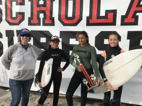 From left, Coach Alisa Cairns with the champion shortboard team of Kalohe Danbara, Tess Booth and Kelly Smith