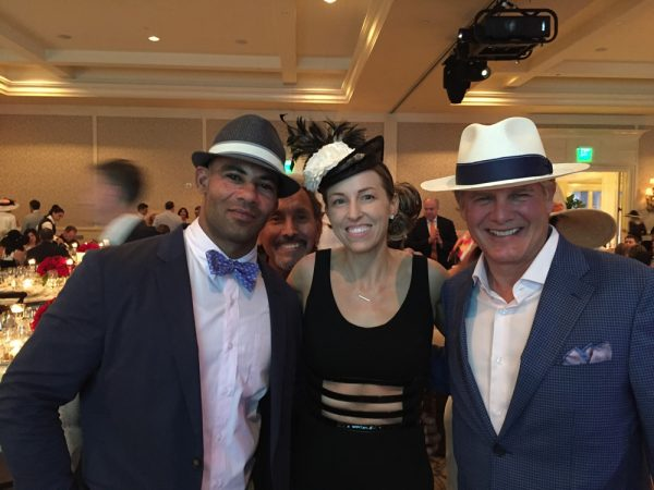 Club supporters, from left, Renato DaRocha, Dr. Adrienne DaRocha and Brad Arnold show they're  game for Derby Day.