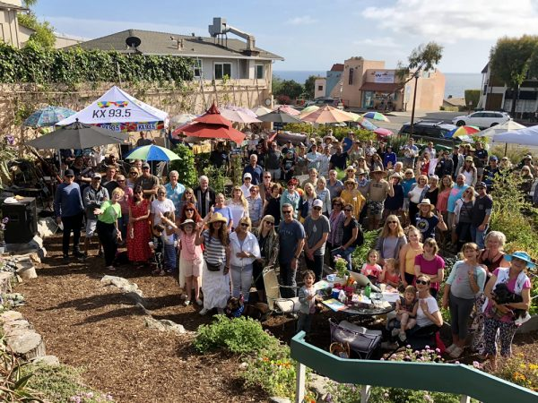 South Laguna Community Garden draws a crowd at a recent potluck and memorial for one of the garden's founders, Morrie Granger. Small steps are being taken towards its purchase.