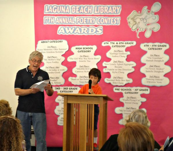 The ever-animated master of ceremonies John Gardiner presides over the poet contest presentations.