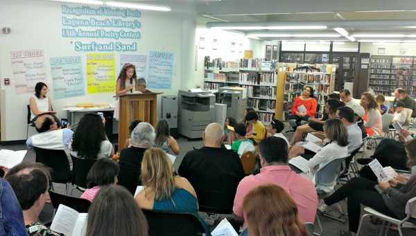 An appreciative audience listens to a poet contest winner in 2016.