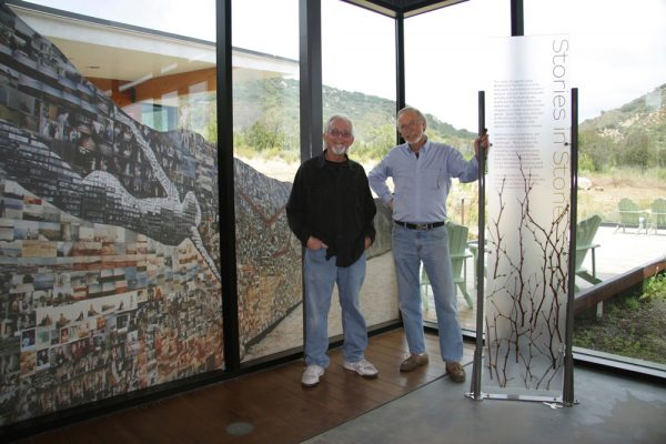 From left, Jerry Burchfield and Mark Chamberlain, in 2009 with a fragment of the photo mural that is credited with helping preserve open space in Laguna Canyon.
