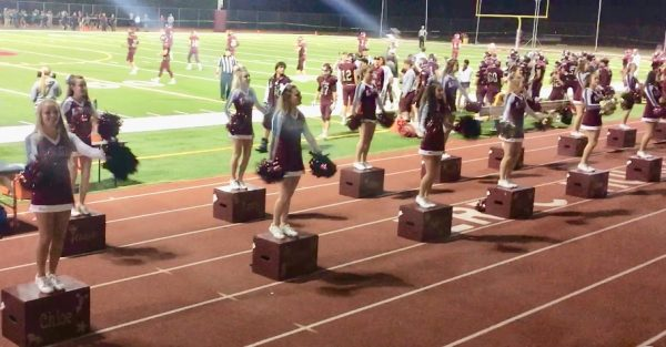 The LBHS cheer team gets the sideline crowd fired up.