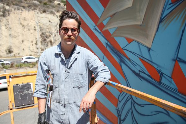 Artist Beau Stanton at work on his mural for Laguna Beach Beer Company, part of a remake underway of a commercial center in Laguna Canyon. Photo by Allison Jarrell