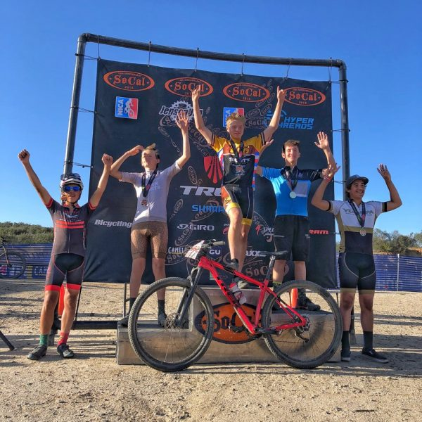 Brady White, second from left, finishes second in a mountain bike race at Lake Vail, Calif.