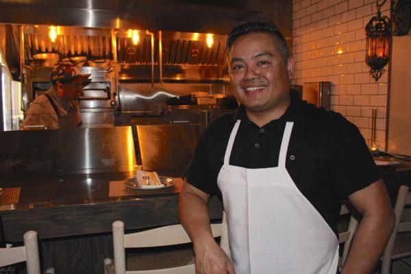 Chef Robert Villanueva outside Roux's open kitchen.