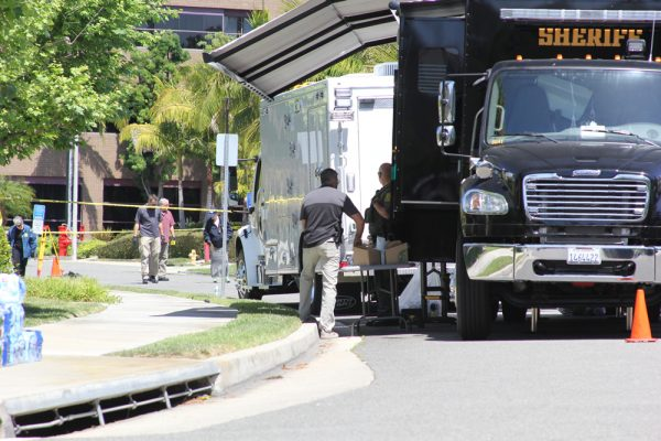 The FBI's evidence team examines the scene of a bombing in Aliso Viejo.