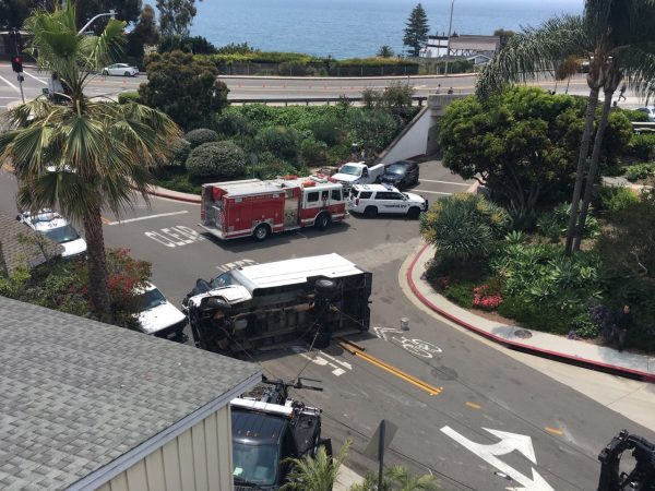 A tow truck arrives to right a truck overturned at Nyes Place. Photo courtesy of LBPD.