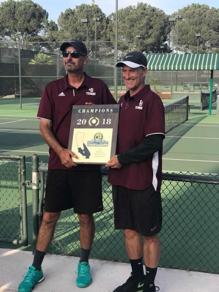 Coaches Rick Conkey and Nic Radisay show off their CIF championship plaque. Photos by Carrie Reynolds