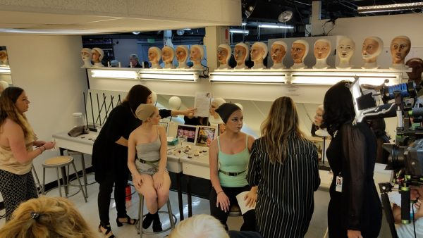 Models and makeup artists prepare to recreate three works of art for a media preview night on June 4. Photos by Allison Jarrell.