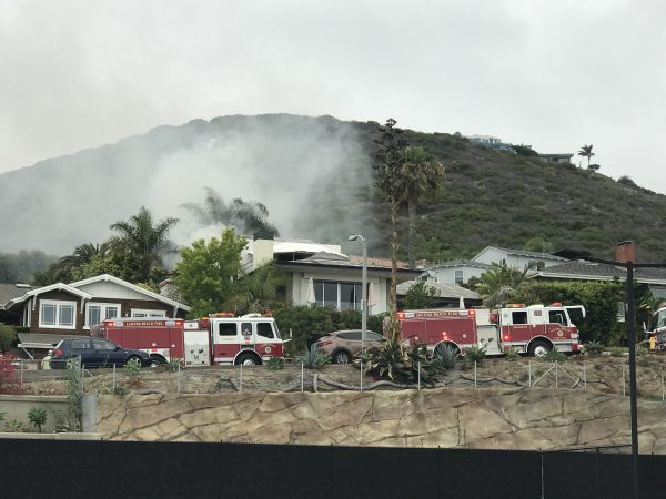 Smoke rises from a Manzanita Drive home partially destroyed by fire Saturday, June 23. Photo courtesy of Rose Hancock