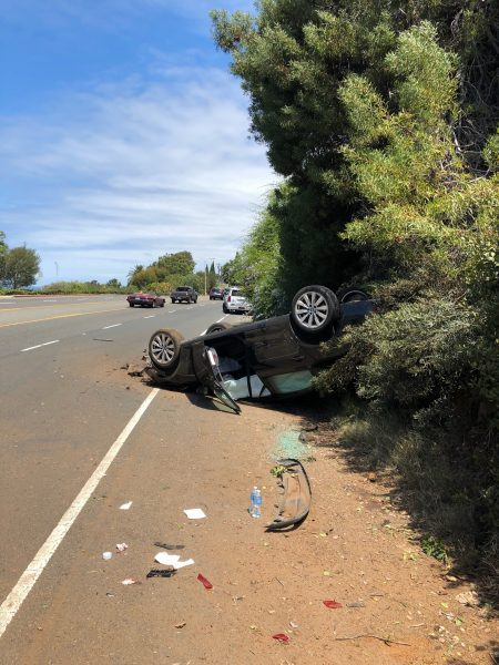 Two occupants were injured in a car that overturned near Three Arch Bay after a collision with a suspected drunk driver. Photo courtesy of LB PD