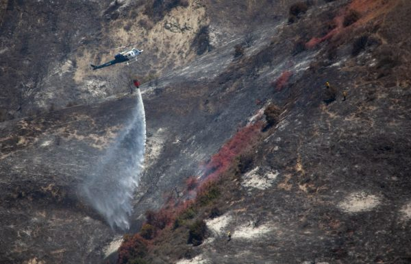 A helicopter drops water on a hot spot Sunday, June 3. Photo by Allison Jarrell.