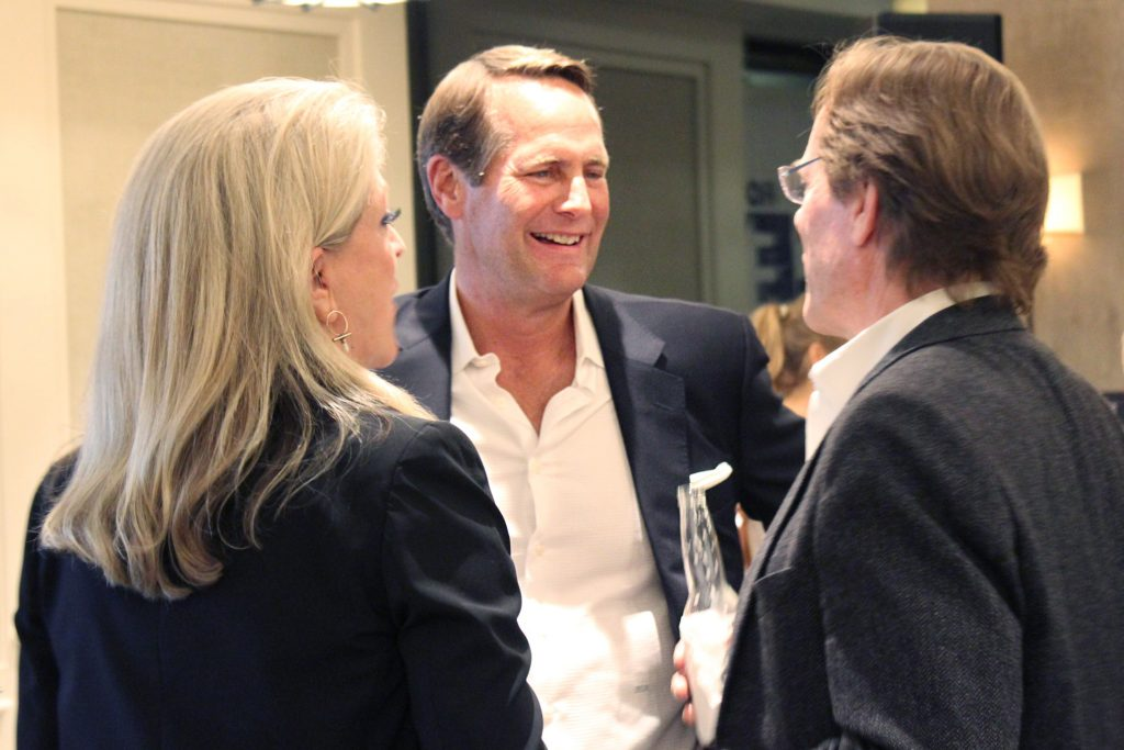 Candidate Harley Rouda talks with supporters and former candidate Laura Oatman at his election night event at The Ranch in Laguna Beach. — Photo by Victoria Kertz ©