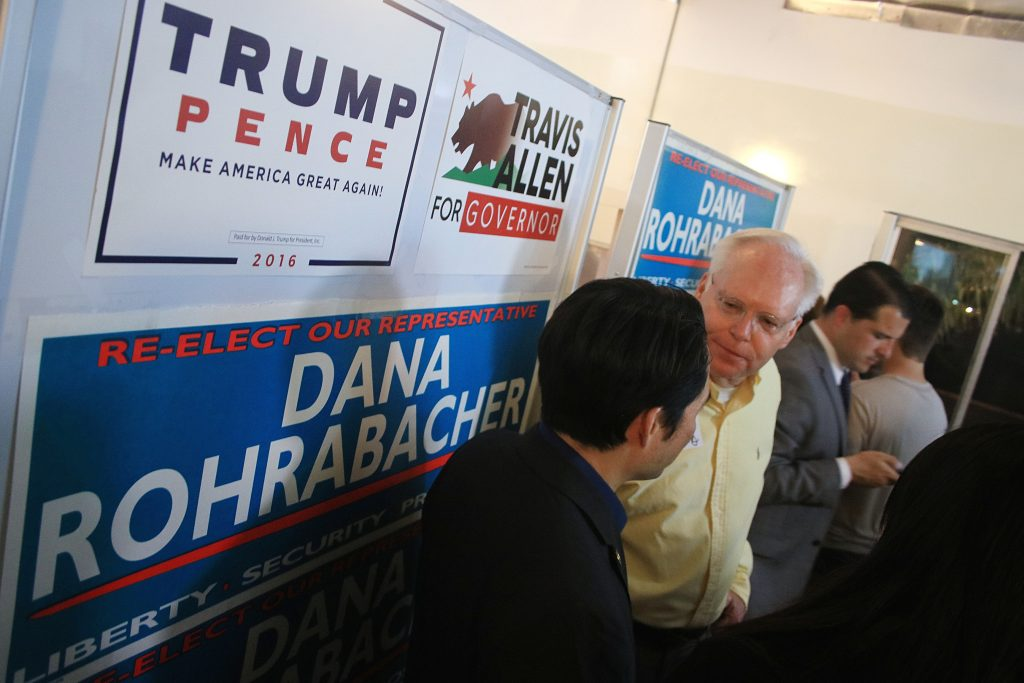 Supporters of Republican incumbent Dana Rohrabacher chat as they wait for updates on the election at Rohrabacher's event Tuesday. — Photo by Sara Hall ©