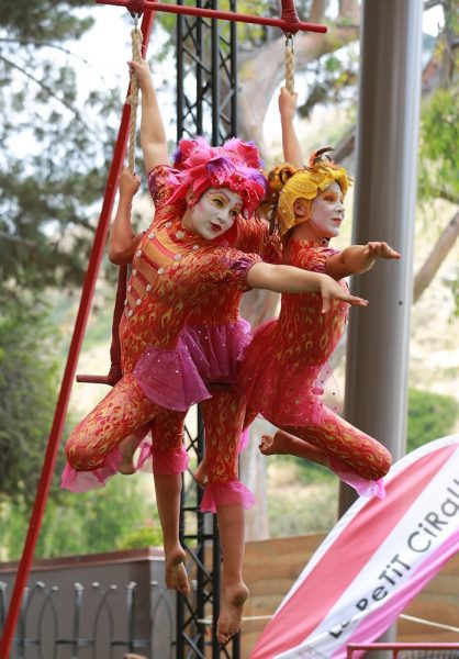 An aerial act will entertain visitors Sunday at the Festival of Arts.