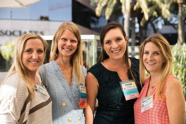 With My Own Two Hands' grant recipients, Darcy Purvis, far left, and Mary Beth Pugh, far right, celebrate with Impact Giving partners Jennifer Grzeskowiak and Annie Cronin, center left and right, respectively.