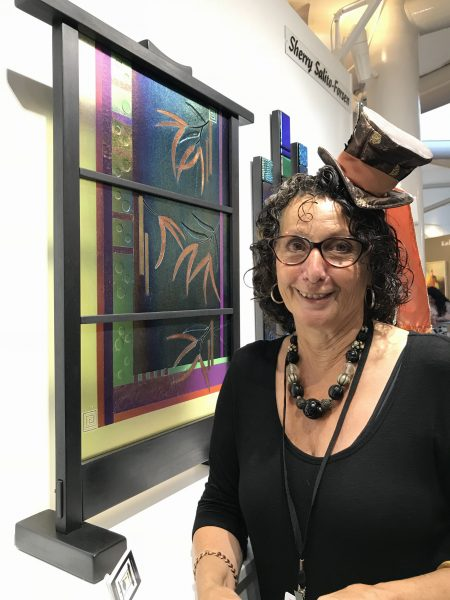 "Exhibitor Sherry Saleto Forzen with her ""Quiet Woman"" glass work."