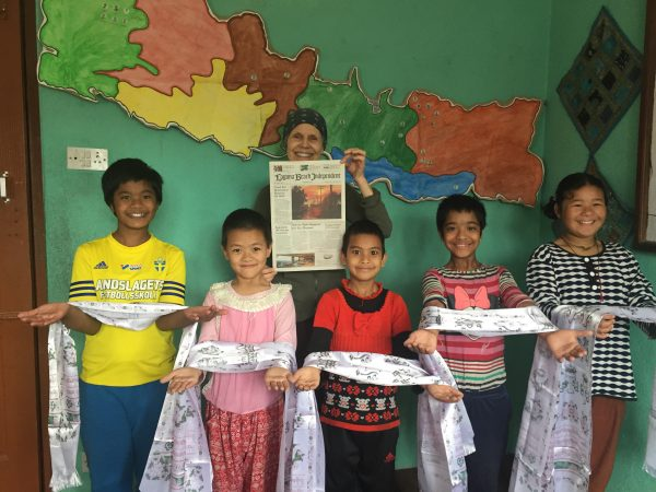 Christine Casey, founder and president of chhahari, Inc. shares a copy of the Indy at a Chhahari home for at-risk and orphaned children in Kathmandu, Nepal in April.