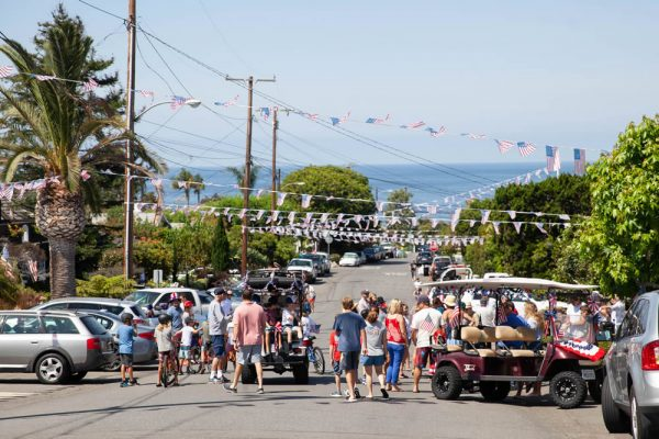 Laguna residents gather on Brooks Street Wednesday morning for the annual Fourth of July parade and block party. Photo by Allison Jarrell.