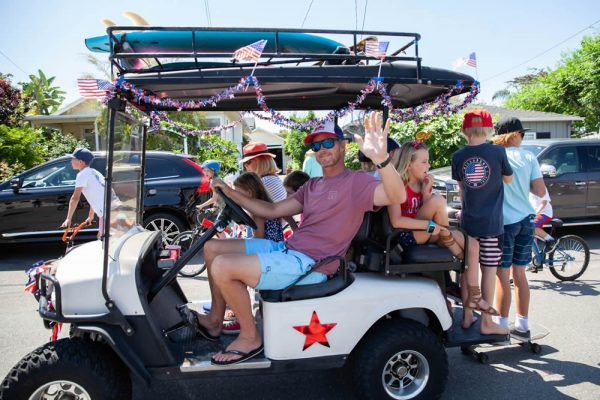 Families got into the holiday spirit with decorated golf carts and other vehicles during the annual Brooks Street parade.