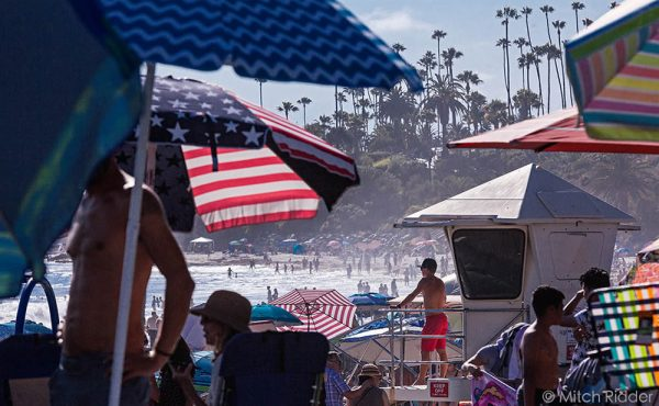 Crowds took advantage of the holiday for a mid-week beach day. Photo by Mitch Ridder.