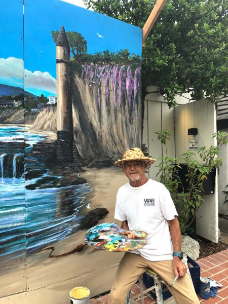 Sawdust artist Walter Viszolay brought the festival's mural back to life with a Victoria Beach scene. Photo courtesy of Sawdust Art Festival