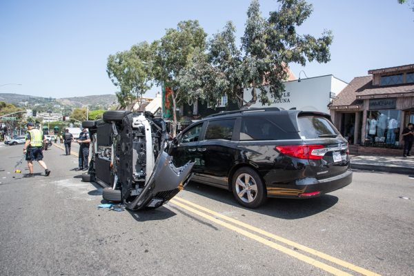 Police and medics responded to a vehicle rollover just after 11 a.m. on Friday, Aug. 17, and closed lanes between Legion Street and Laguna Avenue. Photo Dondee Quincena