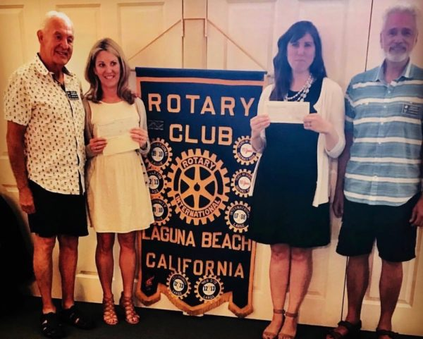 From left, outgoing Rotary Club of Laguna Beach president Stan Carmichael, Anne Belyea, executive director of the Laguna Food Pantry, Friendship Shelter marketing and development director Kristin Points, and Rotarian Jerry Catalano celebrated the Rotary's 2018 grant awards at a recent luncheon. Photo courtesy of Laguna Food Pantry.