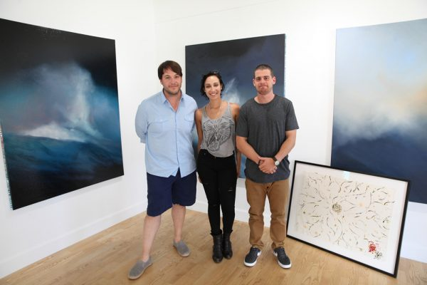Shane Townley's new gallery, Laguna Art, at 305 N. Coast Highway, is slated for a grand opening on Sept. 6. Townley (left) is pictured here with staff member Sahara James and assistant director Dwayne Downing. Photo by Allison Jarrell