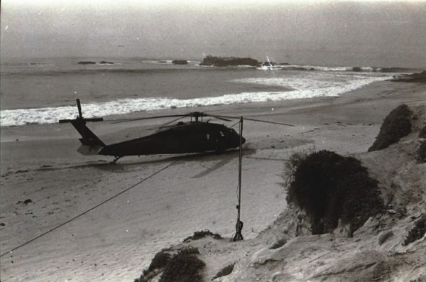 Helicopters land on the beach during the 1993 Laguna Beach wildfire. Photo by Douglas Miller