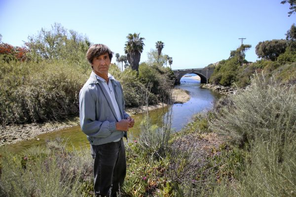 Ed Almanzo, who leads the restoration initiative for the Laguna Ocean Foundation, atop the bridge that historically bordered the Aliso Creek estuary back in 2015. Photo by Jody Tiongco